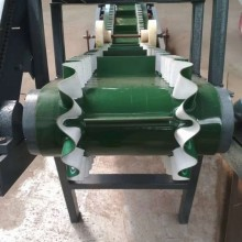 蚌埠爬坡挡边输送机 不锈钢防腐液压升降式输送机